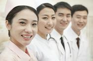 Stock Photo of Healthcare workers standing in a row, China