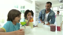 Stock Video Footage of Family Having Breakfast In Kitchen Together