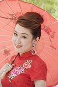 Young Woman in Qipao with Umbrella - stock photo
