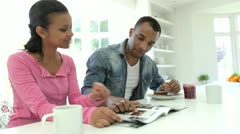 Couple Having Breakfast And Reading Magazine In Kitchen Stock Footage