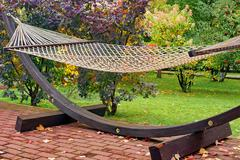 garden hammock in the yard - stock photo