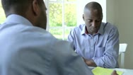 Stock Video Footage of Mature Black Male Meeting With Financial Advisor At Home