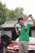 Stock Photo of Father with Son On His Shoulders