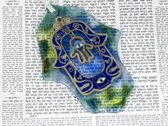hamsa kabala good luck charm on talmud - stock photo