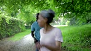 Stock Video Footage of Mature African American Couple Running Along Country Path