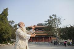 Senior Man Practicing Tai Ji Stock Photos