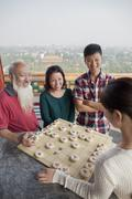 Chinese Family Playing Chinese Chess (Xiang Qi) Stock Photos