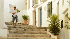 Tourists walking by typical Andalusian streets Stock Footage