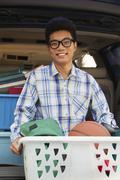 Portrait of boy with college dorm items in back of car Stock Photos