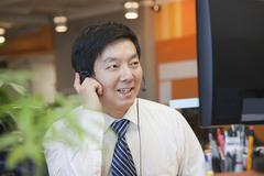 Businessman Wearing Headset in the Office Stock Photos