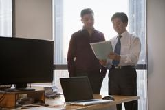 Two Businessmen Working Together in the Office Stock Photos