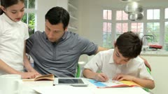 Father Helping Children With Homework - stock footage