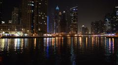 The night illumination of Dubai Marina and Dhow boat Stock Footage