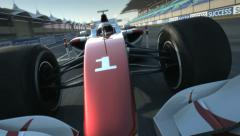 F1 racecar speeding along home stretch Stock Footage