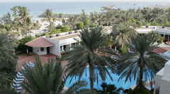 Beach and swimming pool at the luxury hotel, Ajman, UAE Stock Footage