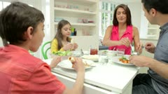Hispanic Family Sitting At Table Eating Meal Together Stock Footage