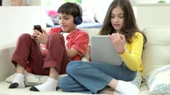 Children Playing With Digital Tablet And MP3 Player - stock footage