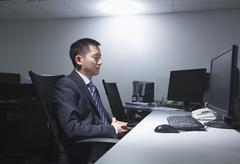 White-collar worker sitting in office - stock photo