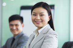 Portrait of Businesswoman with her Colleague - stock photo