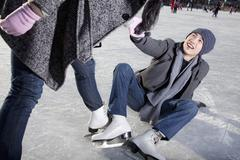 Young couple at ice rink Stock Photos