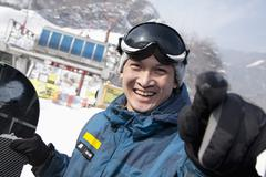 Stock Photo of Smiling Snowboarder in Ski Resort