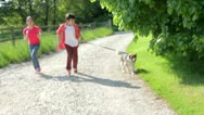 Stock Video Footage of Children Running Along Country Path With Dog