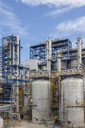 petrochemical plant wit blue sky - stock photo