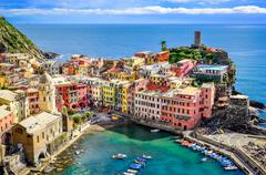 scenic view of ocean and harbor in colorful village vernazza, cinque terre - stock photo