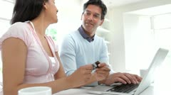 Indian Couple Making Online Purchase At Home Stock Footage