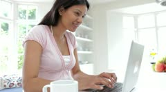 Indian Woman Using Laptop In Kitchen At Home Stock Footage