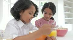 Children Having Breakfast In Kitchen Before School Stock Footage