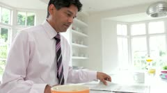 Man Having With Wife Breakfast Before Going To Work Stock Footage