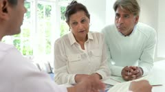 Senior Indian Couple Meeting With Financial Advisor At Home Stock Footage