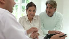 Senior Indian Couple Meeting With Financial Advisor At Home - stock footage
