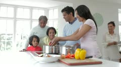 Multi Generation Indian Family Cooking Meal At Home - stock footage