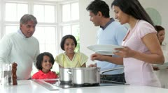Multi Generation Indian Family Cooking Meal At Home Stock Footage