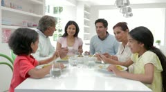 Multi Generation Indian Family Eating Meal At Home Stock Footage