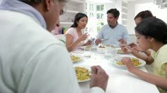 Multi Generation Indian Family Eating Meal At Home - stock footage