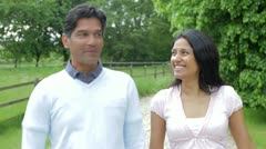 Indian Couple Walking In Countryside Stock Footage