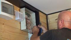 Worker Installing, Repairing a Security System, Man Setting a Secure Alarm Stock Footage