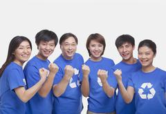 Group of people with raised fists, studio shot - stock photo