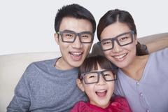 Portrait of Family wearing black glasses, studio shot - stock photo