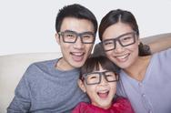 Stock Photo of Portrait of Family wearing black glasses, studio shot