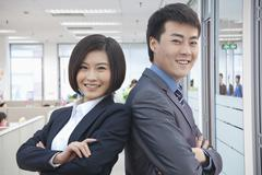 Two Business People with Arms Crossed Stock Photos