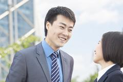 Stock Photo of Two Business People Looking at Each Other