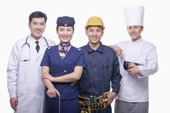 Portrait of Doctor, Air Stewardess, Construction Worker, and Chef- Studio Shot - stock photo