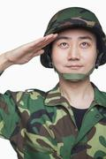 Man in military uniform saluting - stock photo