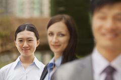 Portrait of three business people, multi-ethnic group - stock photo