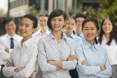 Portrait of group of business people outdoors, Beijing - stock photo