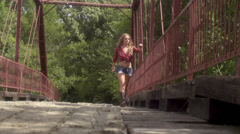 Stock Video Footage of stock footage portraiture -pretty redhead country girl looks over bridge